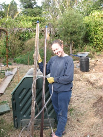 Miranda holding the completed and filled bunyip.  Work the air bubble out of the hose by lifting the bottom.